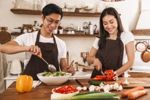 Image,Of,Young,Multicultural,Couple,In,Aprons,Laughing,And,Making